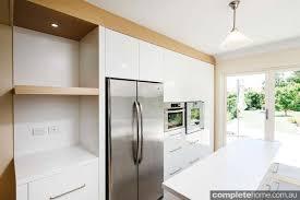 white fridge in kitchen. streamlined white kitchen - stainless steal fridge in