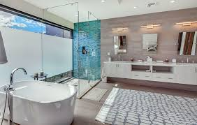Luxury modern bathroom with aqua blue tile in shower