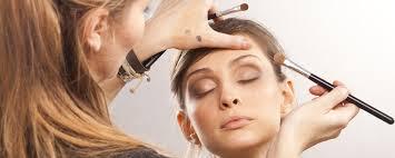 a freelance makeup artist doing a clients eyes