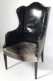 Antique Leather and Cowhide Wingback Armchair