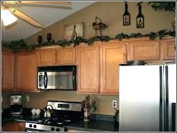 Above Kitchen Cabinet Decorations Best Decorating