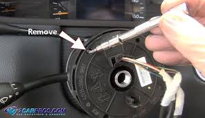 how to remove an airbag clock spring in under 30 minutes the top plate need to be moved slightly in either direction to access all of the mounting screws