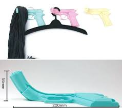 colorful coat hooks. Colorful Wall Hooks This Really Seems Like A Gun Toy Attached On The  However Because Of Curve It Is Transformed Into Coat Hook Available In Three Colorful Coat Hooks