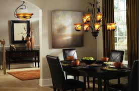 rustic bronze dining room chandelier over black faux leather dining chairs as well as art works portray as dining room decor views