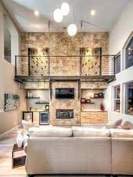 stone fireplace wall trendy open concept medium tone wood floor family room photo in with beige stone fireplace wall