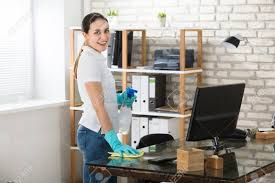 woman office furniture. Happy Young Woman Cleaning The Glass Office Desk With Rag Stock Photo - 82033421 Furniture E
