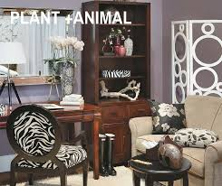 plant and prints go wild by mixing your favorite botanical and prints the black and white zebra print chair makes a statement in this