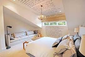 attic bedroom decorating with small chandelier and sofa and wall letters in attic bedroom decorating ideas