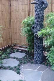 looking out door. This Outdoor Shower Is Surrounded By Natural-looking Rock Speakers. Looking Out Door