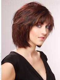 layered brunette chin length haircut with red highlights
