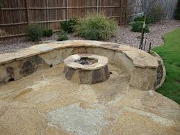 Stacked Stone Fire Pit cream stone floor patio with stacked stone bench and round fire 6999 by xevi.us