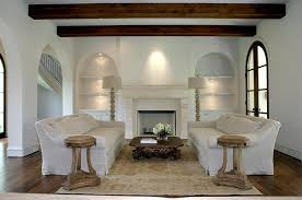 terranean living room with restoration hardware 18th c lion s head side table carpet