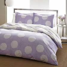 unique white and purple bedding comforter set featuring glass bedside table