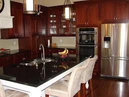 Cherry Kitchen Cabinets With White Appliances dark wood kitchen
