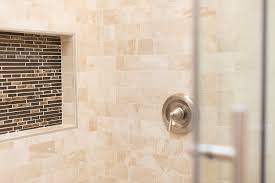 in this remodel below we used white glass subway tile if our clients want to go with the traditional layout we always urge them to go with a tile that s