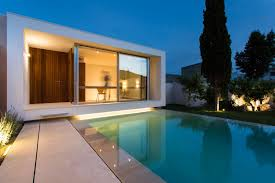 A home office overlooking a swimming pool was designed for this