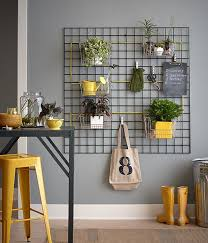indoor wall garden. Hang Kitchen Baskets On A Mounted Wall Trellis And Fill With Plants For An Indoor Vertical Garden