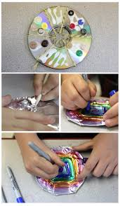 A fancy way to recycle old CDs. Glue designs with buttons and string, cover