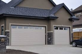 image of garage doors with windows panel