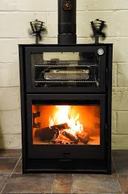 hergom laredo wood burning stove with integral oven and firebox cooking racks