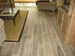 image of wood look tile vs hardwood color