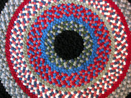 33 round wool braided rug hand laced in black red blue green in pattern style made with coat weight wool