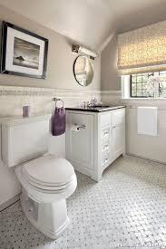 bathroom and basketweave tile chair rail marble tile roman shade round mirror slanted ceiling subway tile tan paint tile accent tile floor white vanity
