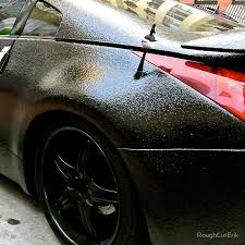 this 370 z looks pretty radical with a bedliner paint job some bedliner systems allow you to add tint which is probably what this is very cool
