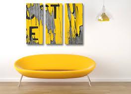yellow grey and black wall art