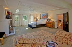 inviting wall to carpet in beige color with flowery design decorate bedroom