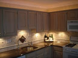 sink lighting kitchen light fixtures fixture above recessed lamp under cabinets wall cabinet system with faucet