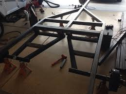 because i have the lift cable s running under the body i really didnt want to notch the main rails i bought 1 5 x2 tubing to run on top and then cut it