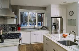 kitchen design white cabinets stainless appliances. Beautiful Appliances Sharp White Cabinetry Meets A Microtile Backsplash In This Highly  Detailed Cozy Kitchen In Kitchen Design White Cabinets Stainless Appliances H