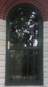 Simple Round Top Storm Door With Clear Glass Cover And Teak Wood ...