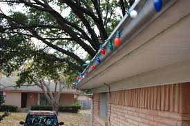How To Fasten Christmas Lights To House Hanging Christmas Lights Made Easy 4 Steps With Pictures