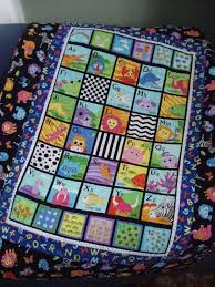 Finished quilts of 2011 | Quilt Addicts Anonymous & There was the alphabet baby quilt for my friend Shelly's first child. We  know each other from book club, so I thought this panel that I already had  in my ... Adamdwight.com