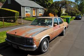 OLD PARKED CARS.: 1977 Chevrolet Concours.