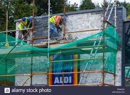 Scaffold Builders Builders On Scaffolding Or Scaffold Removing Brickwork From