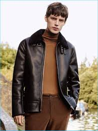 english model callum ward sports a faux leather jacket with a turtleneck and corduroy pants from