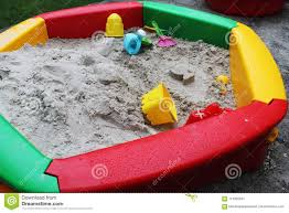outdoor colorful garden toys for children in sandpit full of sand