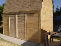 make sliding barn doors using skateboard wheels