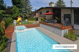 Patio with pool Raised Patio With Inground Pool By Patio Design Inc Inspiratdesign Patio Design Construction Design Of Patios For Pool