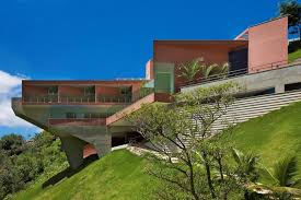view in gallery sculptural concrete house built on a steep slope