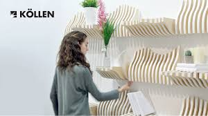 Modular and interactive bookshelf formed by pieces which can be placed  differently depending on the objects