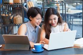 Premium Photo | Two asian woman talking about business and using laptop in  coffee shop