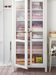 Ikea Smadal bookcase with glass doors... line the back with pretty paper.