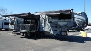 2016 cyclone cy4200 toy hauler king bed 2 full baths side patio deck 3 a c rv