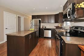 Kitchen With Laminate Flooring The Haliburton Barzotti Cabinets Maple Swedish Walnut