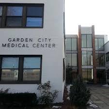 dentist in garden city center for dental excellence