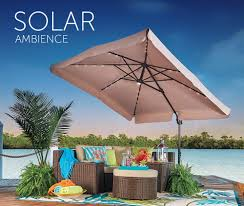 outdoor living space with patio furniture and solar lighted patio umbrella